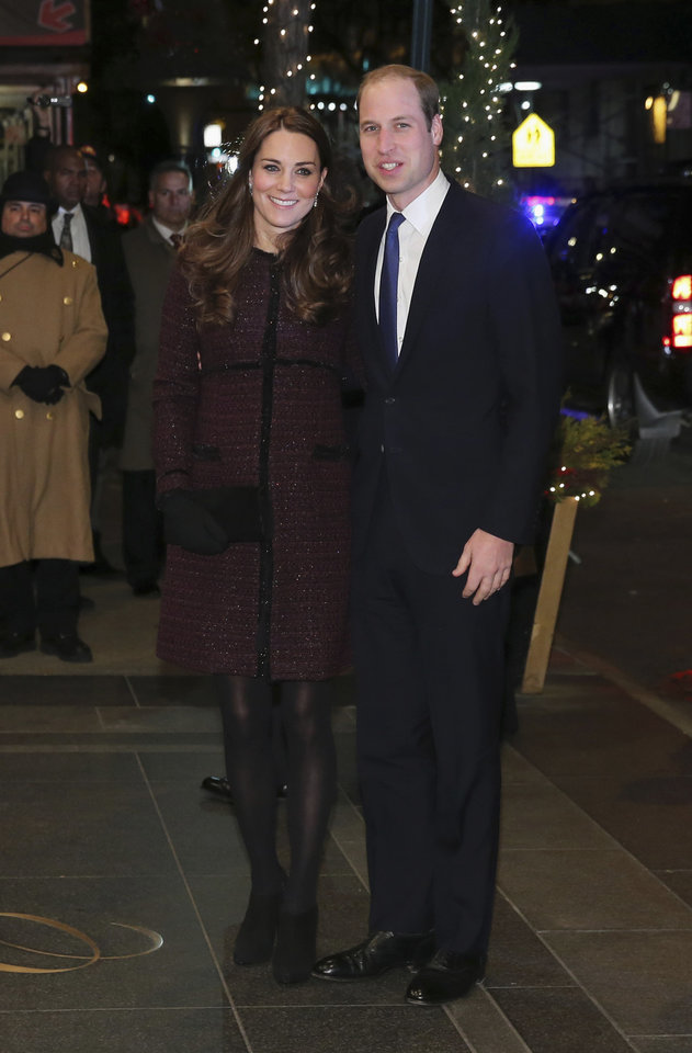 Photo - Kate, left, Duchess of Cambridge and Britain's Prince William arrive at The Carlyle Hotel, Sunday, Dec. 7, 2014, in New York. They have a full schedule of events in New York, including a visit to the National Sept. 11 Memorial and Museum and an NBA basketball game between the Brooklyn Nets and the Cleveland Cavaliers. (AP Photo/Neilson Barnard, Pool)