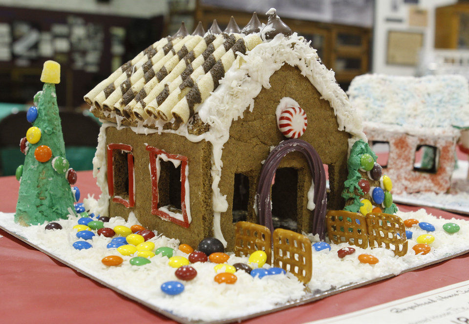 One of the entries in the fourth annual gingerbread house contest at the Edmond Historical Society and Museum. PHOTO BY PAUL HELLSTERN, THE OKLAHOMAN. <strong>PAUL HELLSTERN - OKLAHOMAN</strong>