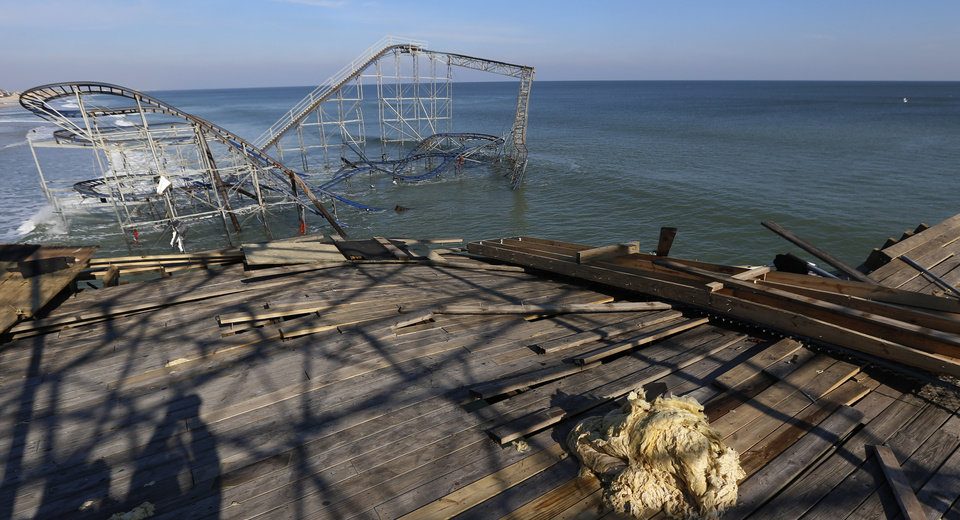 A roller coaster that once stood on the Funtown Pier at Seaside Heights is seen dunked in the ocean after the pier was hit by Superstorm Sandy, Thursday, Nov. 29, 2012, in Seaside Heights, N.J. The New Jersey General Assembly took a tour of areas hit a month after the storm. (AP Photo/Julio Cortez)