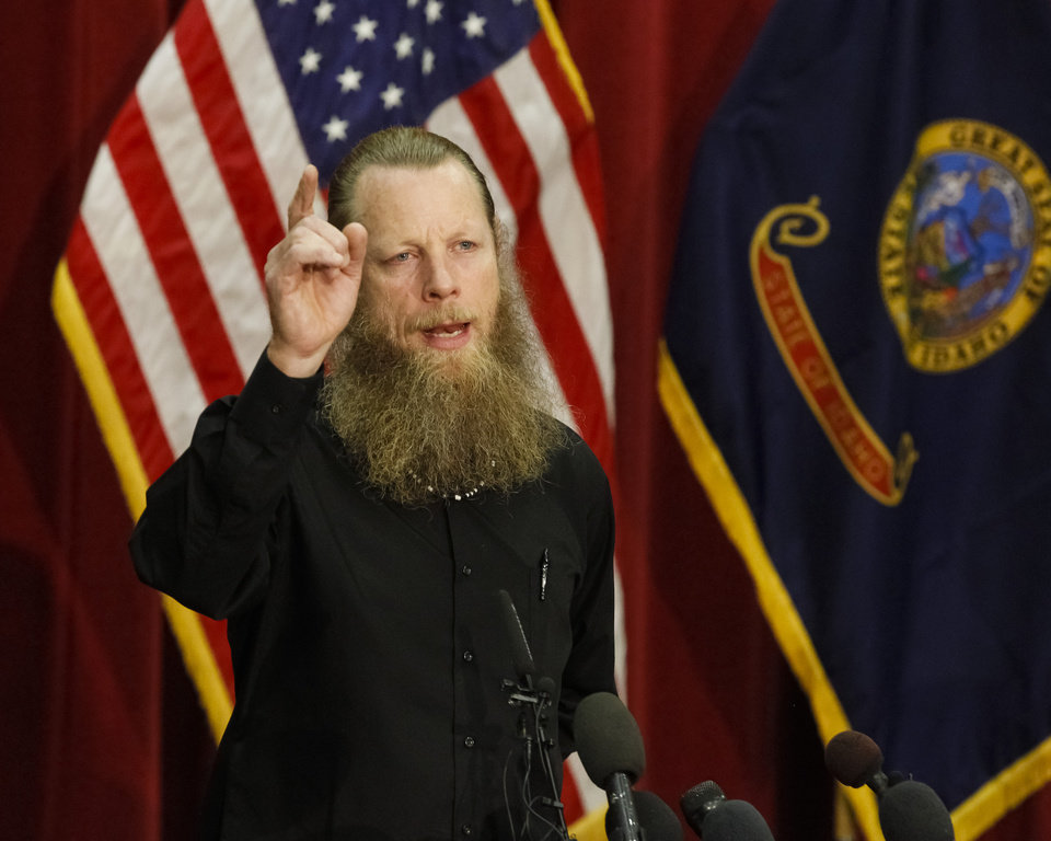 Photo - Bob Bergdahl thanks the POW/MIA bikers in the back row while speaking to the media during a press conference at Gowen Field in Boise, Idaho, on Sunday, June 1, 2014.(AP Photo/Otto Kitsinger)