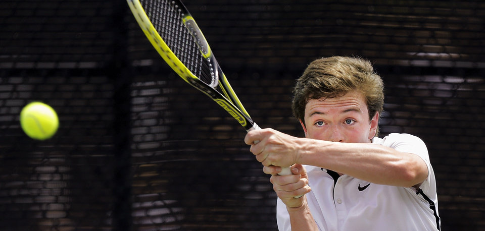 Photo - Lucas Meacham of Crossings Christian, playing against Blake Crawford of Mt. St. Mary during state championship tennis tournaments at the OKC Tennis Center on N. Portland Saturday afternoon, May 17, 2014. Photo by Jim Beckel, The Oklahoman