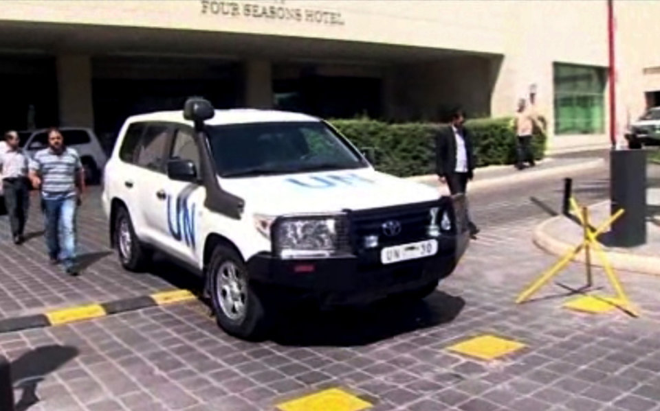 Photo - In this image taken from AP Television, a UN vehicle leaves the Four Seasons Hotel in Damascus Syria, Tuesday, Aug. 27, 2013. The head of the UN chemical inspectors team, Ake Sellstrom, and the UN's disarmament chief, Angela Kane, left their hotel in Damascus on Tuesday. The Syrian foreign minister later said that the second UN trip to the alleged attack site was delayed by disputes between rebels. (AP Photo/AP Video)