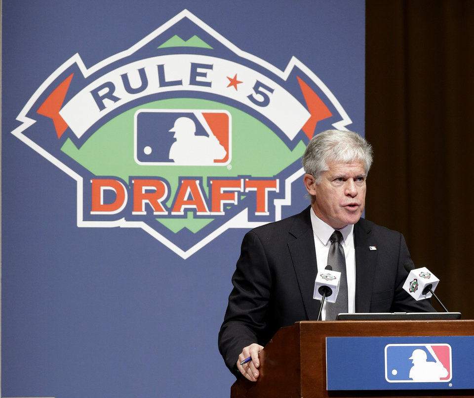 Roy Krasik, senior director of Major League Baseball operations, directs the Rule 5 draft at the baseball winter meetings on Thursday, Dec. 6, 2012, in Nashville, Tenn. (AP Photo/Mark Humphrey)