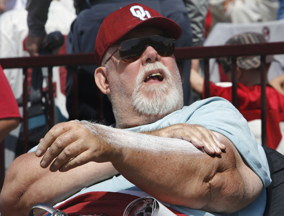 Ray Jackson of Norman applies sun screen liberally during the University of Oklahoma Sooner's (OU) Spring Football game at Gaylord Family-Oklahoma Memorial Stadium on Saturday, April 16, 2011, in Norman, Okla.  