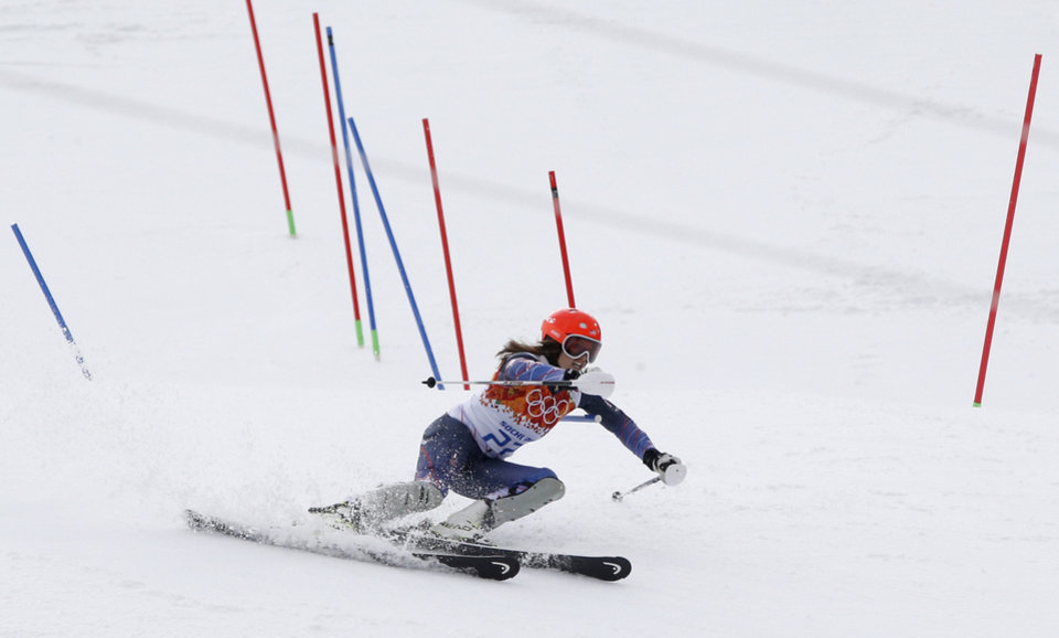 Photo - Bronze medal winner United States' Julia Mancuso passes a gate in the slalom portion of the women's supercombined at the Sochi 2014 Winter Olympics, Monday, Feb. 10, 2014, in Krasnaya Polyana, Russia. (AP Photo/Christophe Ena)