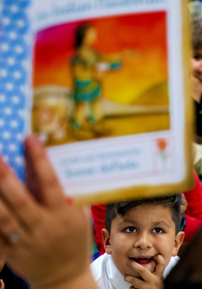 Photo - Heronville Elementary first grader David Maldonado listens to a lesson from his teacher Alicia Strawn about the story of Thanksgiving from the Native American perspective while in class at Heronville Elementary in Oklahoma City, Okla. on Thursday, Nov. 21, 2019. [Chris Landsberger/The Oklahoman]