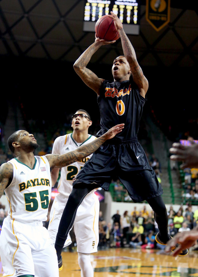 Photo - Long Beach State's Kris Gulley (0) shoots over Baylor's Pierre Jackson (55) during the first half of their first-round game in the NIT college basketball tournament, Wednesday, March, 20, 2013, in Waco, Texas. (AP Photo/The Waco Tribune-Herald, Rod Aydelotte)