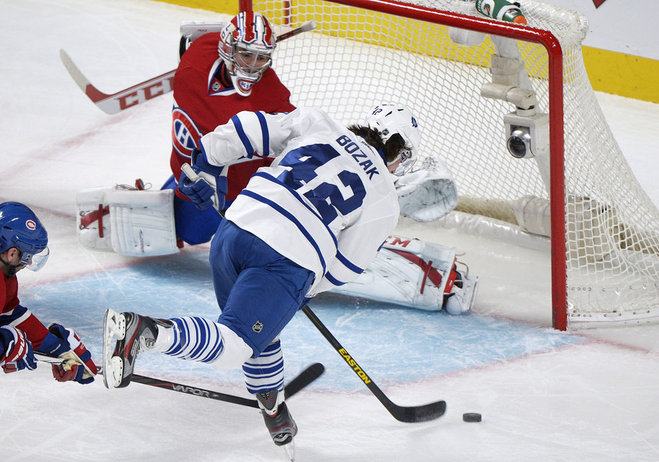 Montreal Canadiens\' goaltender Carey Price can\'t stop a goal by Toronto Maple Leafs\' Tyler Bozak (42) during the first period of an NHL hockey game in Montreal, Saturday, Feb. 9, 2013. (AP Photo/The Canadian Press, Graham Hughes)