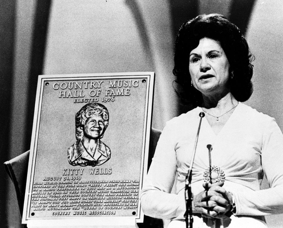 Photo -   FILE - This 1976 file photo shows Country Music Hall of Fame inductee Kitty Wells during the Country Music Association (CMA) awards in Nashville, Tenn. Wells, the first female superstar of country music, has died at the age of 92. The singer's family says Wells died at her home Monday after complications from a stroke. Her recording of