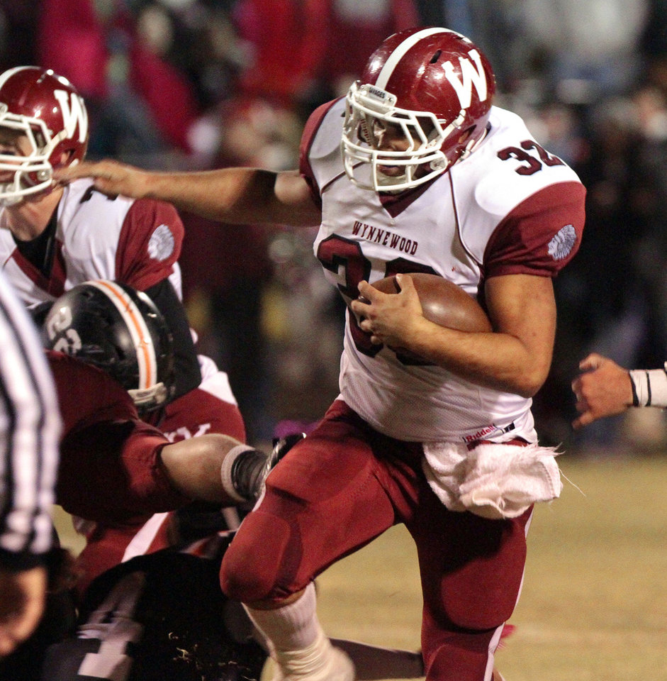 Wynnewood's Trey Knowles runs around end on a touchdown play against  Wayne in high school Football on Friday, Oct. 26, 2012 in Wayne, Okla.  Photo by Steve Sisney, The Oklahoman