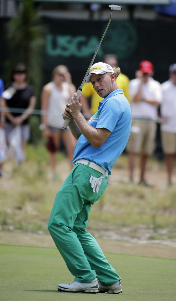Photo - Marcel Siem, of Germany, reacts after missing a putt on the fourth hole during the third round of the U.S. Open golf tournament in Pinehurst, N.C., Saturday, June 14, 2014. (AP Photo/Eric Gay)