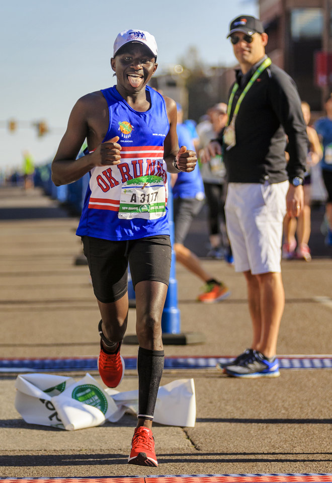 Photo - Nathan Chamer reacts after winning the men's marathon during the Oklahoma City Marathon in Oklahoma City, Okla. on Sunday, April 29, 2018. Ths was Chamer's first marathon he has run. Photo by Chris Landsberger, The Oklahoman
