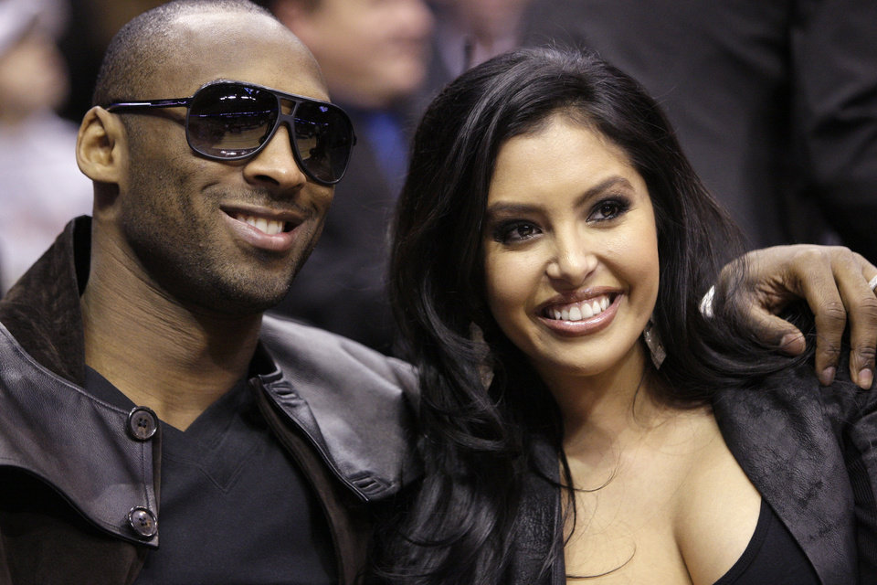 Photo - File-This Feb. 13, 2010 file photo shows Los Angeles Lakers' Kobe Bryant and his wife, Vanessa, attending the skills competition at the NBA basketball All-Star Saturday Night in Dallas.  The Los Angeles Lakers superstar and his wife both announced they've called off their divorce Friday Jan. 11, 2013, on social media. Shortly after Vanessa posted the news on Instagram, Kobe confirmed it on Facebook less than an hour before the Lakers hosted the Oklahoma City Thunder. (AP Photo/LM Otero, File)