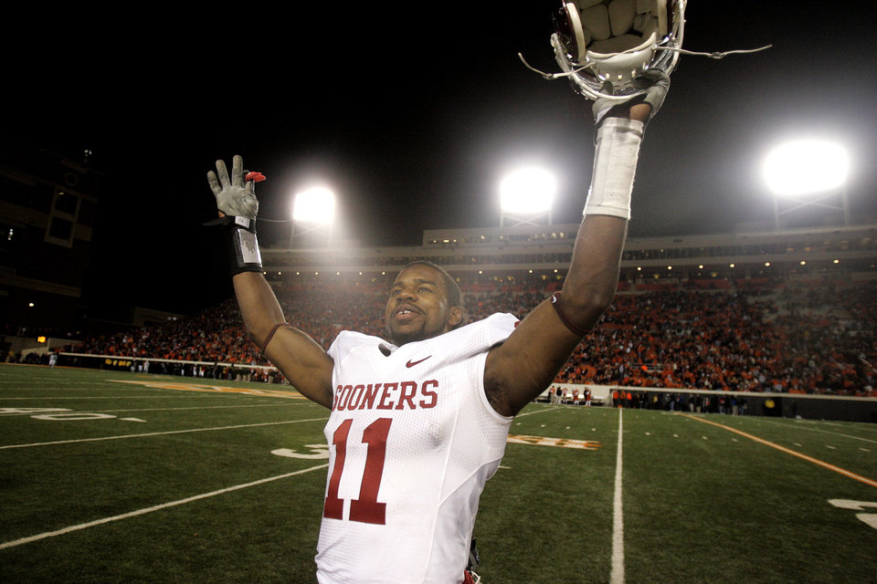 Photo - OU's Lendy Holmes (11) celebrates as the clock winds down during the college football game between the University of Oklahoma Sooners (OU) and Oklahoma State University Cowboys (OSU) at Boone Pickens Stadium on Saturday, Nov. 29, 2008, in Stillwater, Okla. STAFF PHOTO BY SARAH PHIPPS