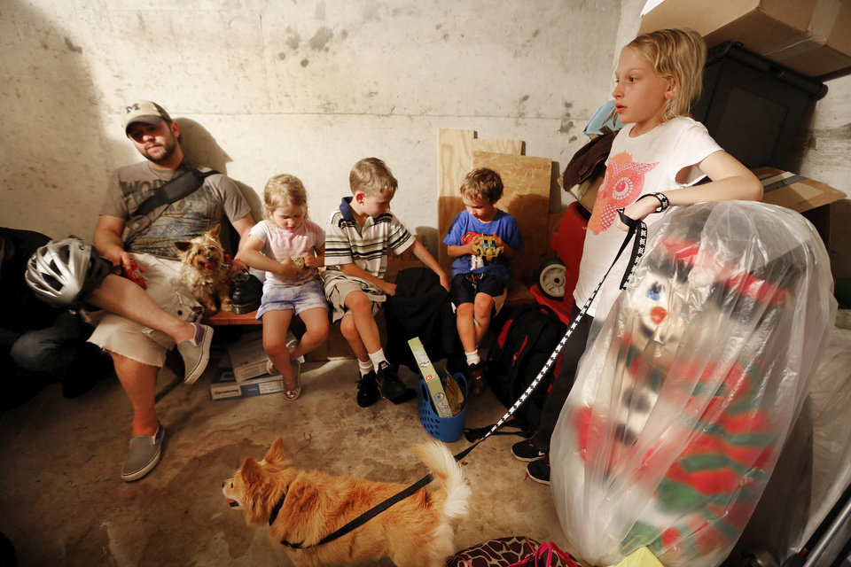 Jeff Short, left rides out tornado warnings with his children and neighbors Tori Short, 4yr, Nate Melott,7yr, Andrick Short, 7yr, Natalie Melott, 10yr,  in a storm shelter in NW Oklahoma City , Friday May 31, 2013.Photo By Steve Gooch, The Oklahoman
