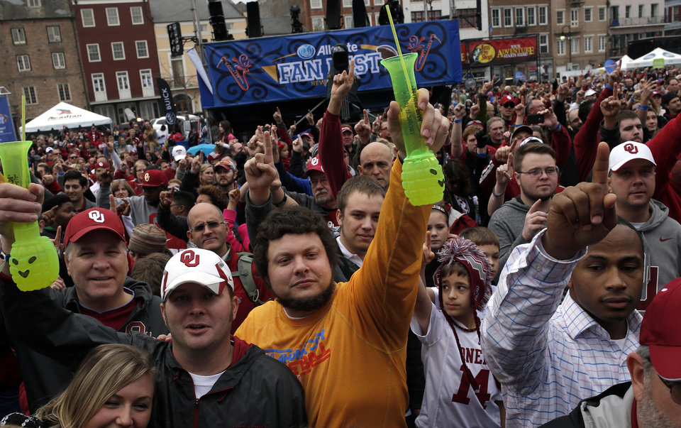 Photo - Oklahoma fans Jeff Gillett of Covington, Okla., left, and Jeremy Barrett of Moore, Oka., cheer during a pep rally in the French Quarter, Wednesday, Jan. 1, 2014 in New Orleans. Photo by Sarah Phipps, The Oklahoman
