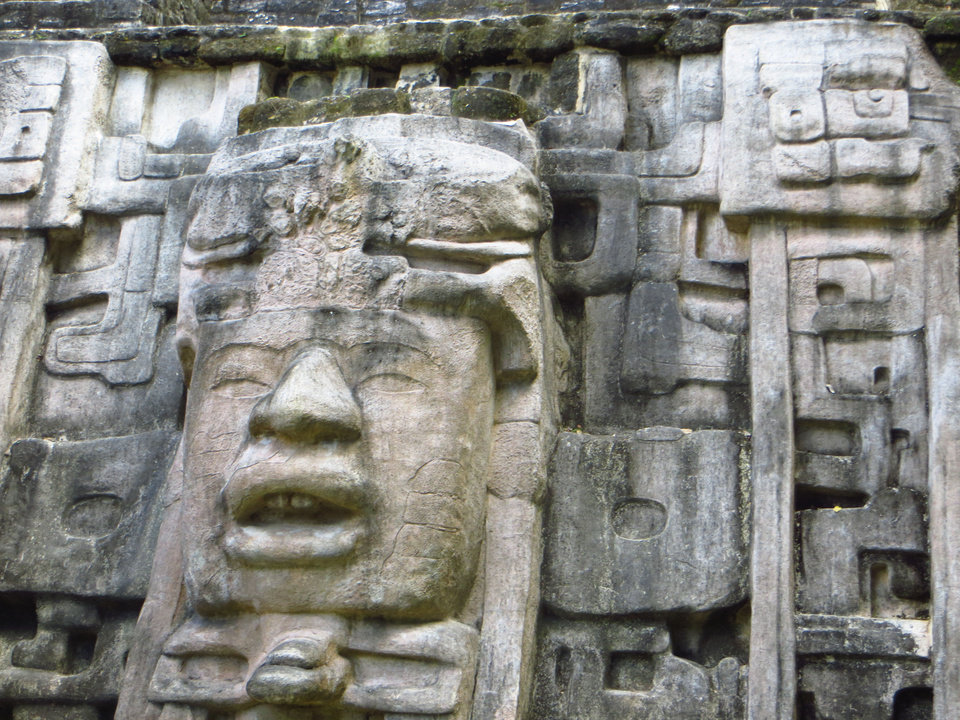 The two masks that adorn the Mask Temple are unique in the Maya area because they were cut from limestone.  Photo by Wesley K.H. Teo <strong></strong>