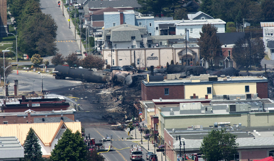 Photo - Damage in the downtown of Lac Megantic, Quebec is seen Sunday, July 7, 2013, the day after a train derailed causing explosions of railway cars carrying crude oil. (AP Photo/The Canadian Press, Paul Chiasson)