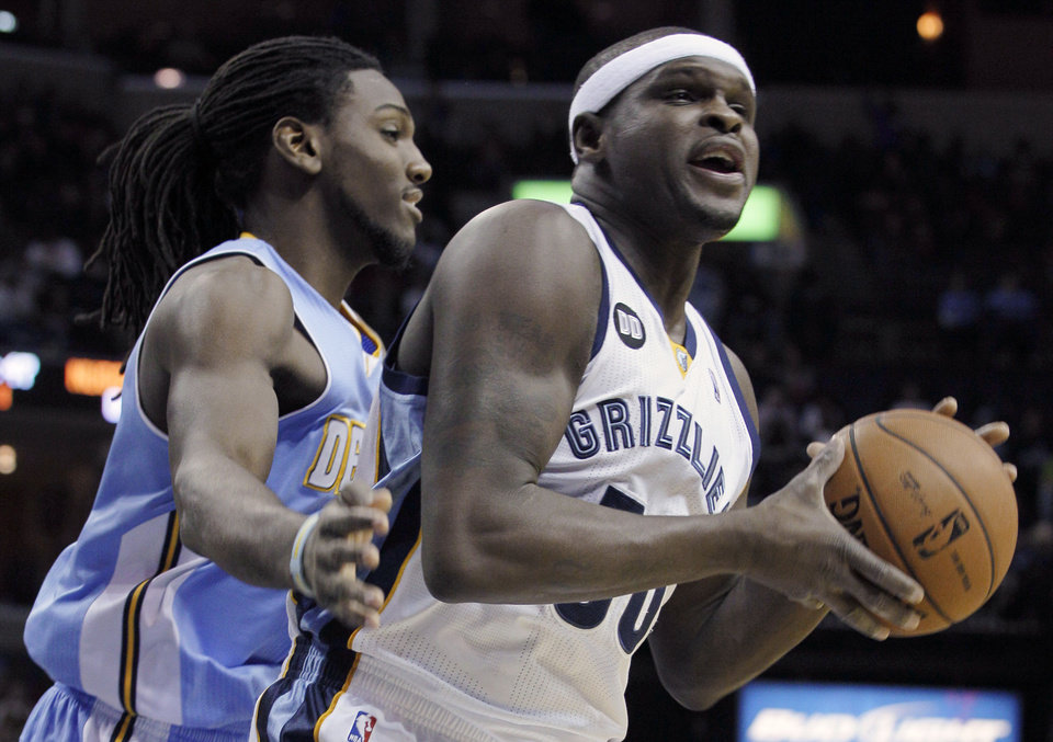 Denver Nuggets' Kenneth Faried, left, guards Memphis Grizzlies' Zach Randolph during the first half of an NBA basketball game in Memphis, Tenn., Monday, Nov. 19, 2012. (AP Photo/Danny Johnston)