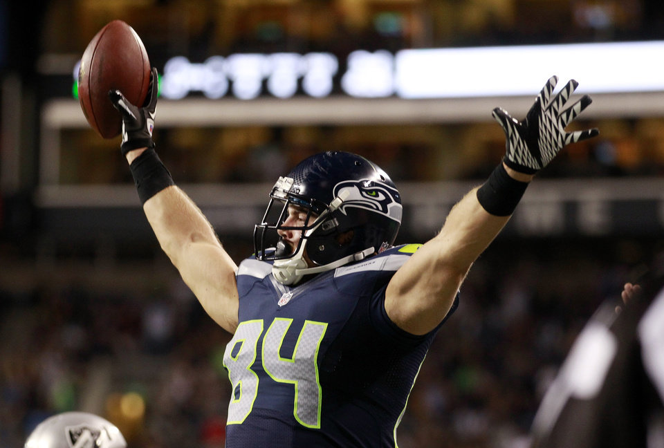 Photo -   Seattle Seahawks' Cooper Helfet reacts after scoring a touchdown against the Oakland Raiders in the second half of a preseason NFL football game Thursday, Aug. 30, 2012 in Seattle. (AP Photo/Stephen Brashear)