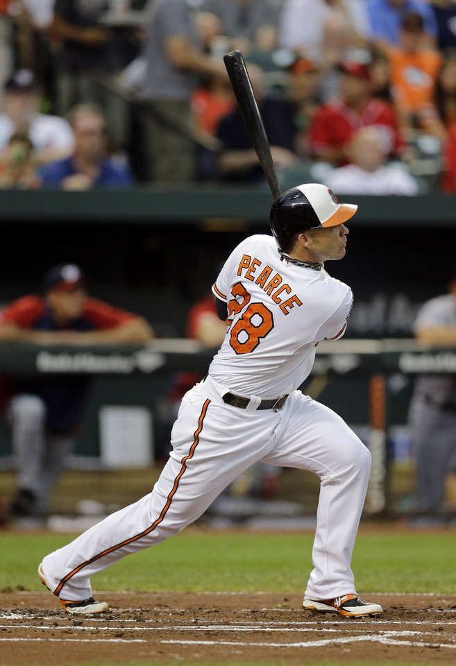 Photo - Baltimore Orioles' Steve Pearce watches his solo home run in the first inning of an interleague baseball game against the Washington Nationals, Thursday, July 10, 2014, in Baltimore. Baltimore won 4-3. (AP Photo/Patrick Semansky)