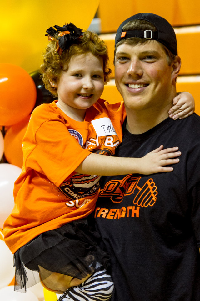 Cooper Bassett and Taylor Brandt pose for a photo. Oklahoma State University hosted a Coachs vs. Cancer Birthday party in Gallagher-Iba arena in Stillwater, Ok on Sept. 16, 2012. Photos by Mitchell Alcala for the Oklhaoman