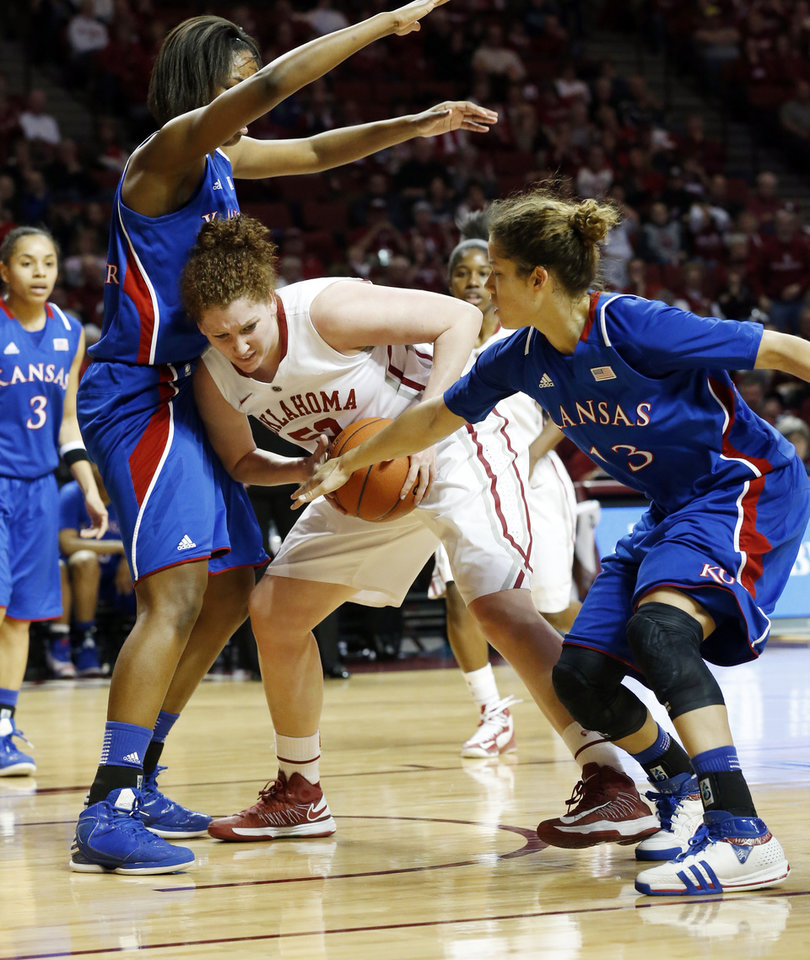 Photo - Oklahoma Sooner's Joanna McFarland (53) tries to keep possession in the lane guarded by \kKansas Jayhawks' Chelsea Gardner (15) and Monica Engelman (13) as the University of Oklahoma Sooners (OU) play the Kansas Jayhawks in NCAA, women's college basketball at The Lloyd Noble Center on Saturday, March 2, 2013  in Norman, Okla. Photo by Steve Sisney, The Oklahoman
