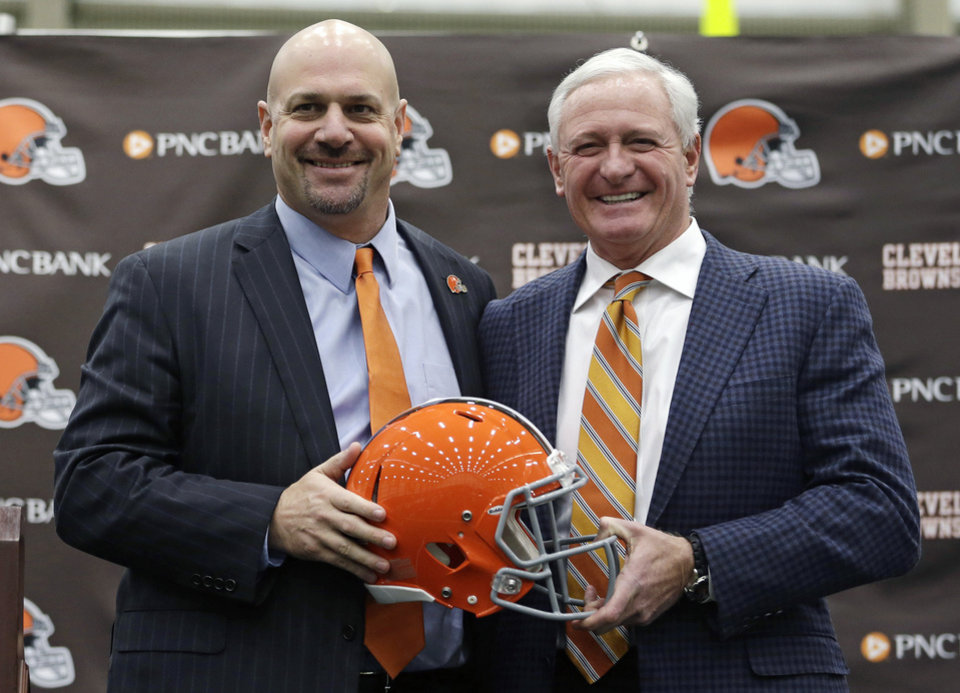 Photo - Cleveland Browns head coach Mike Pettine, left, poses with owner Jimmy Haslam after being introduced to the media Thursday, Jan. 23, 2014, in Berea, Ohio. Buffalo's defensive coordinator, who met with team officials for the first time just a week ago, finalized a contract Thursday to become the Browns' seventh full-time coach since 1999. (AP Photo/Tony Dejak)