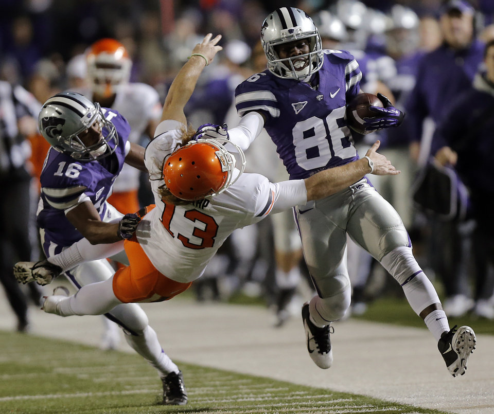 Kansas State's Tramaine Thompson (86) stiff arms Oklahoma State's Quinn Sharp (13) on a kick return during the college football game between the Oklahoma State University Cowboys (OSU) and the Kansas State University Wildcats (KSU) at Bill Snyder Family Football Stadium on Saturday, Nov. 3, 2012, in Manhattan, Kan. Photo by Chris Landsberger, The Oklahoman