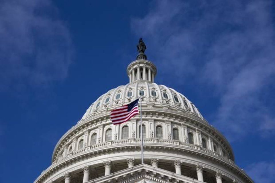 Photo - In this Oct. 14, 2013, photo, the U.S. Capitol is seen as a partial government shutdown enters its third week, in Washington. (AP Photo/J. Scott Applewhite)