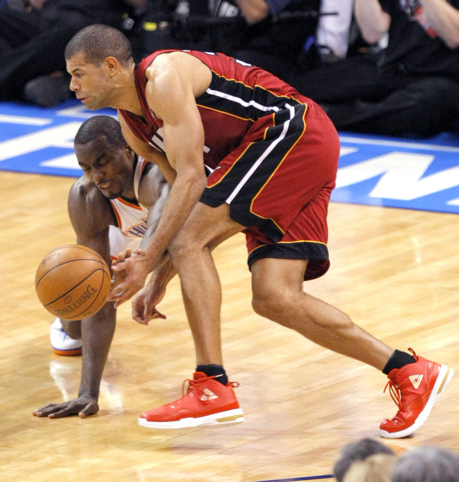 Oklahoma City's Serge Ibaka (9) and Miami's Shane Battier (31) fight for a ball during Game 1 of the NBA Finals between the Oklahoma City Thunder and the Miami Heat at Chesapeake Energy Arena in Oklahoma City, Tuesday, June 12, 2012. Photo by Sarah Phipps, The Oklahoman