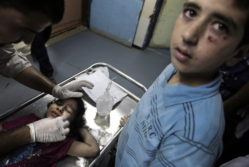 Photo - A wounded Palestinian girl receives treatment at the emergency room of the Shifa hospital following Israeli airstrikes in Gaza City, Tuesday, Aug. 19, 2014. Israel resumed its campaign of airstrikes in Gaza on Tuesday in response to a barrage of Palestinian rocket fire that shattered a truce. The sudden burst of fighting has threatened to derail an Egyptian effort to end a monthlong war between Israel and Hamas militants in Gaza. (AP Photo/Khalil Hamra)