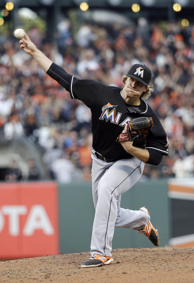 Photo - Miami Marlins starting pitcher Tom Koehler throws to the San Francisco Giants during the fifth inning of a baseball game on Saturday, May 17, 2014, in San Francisco. (AP Photo/Marcio Jose Sanchez)