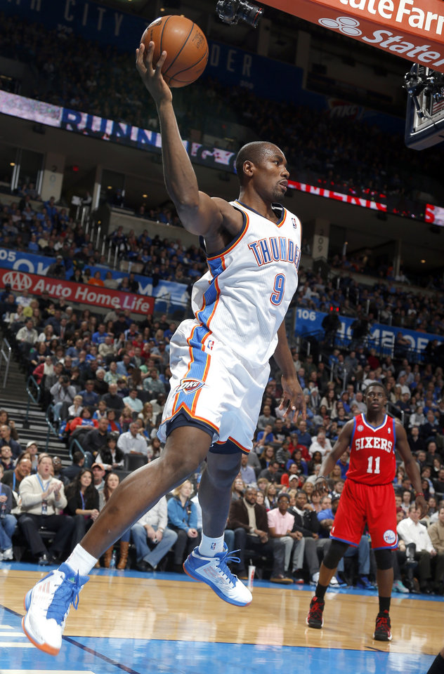 Oklahoma City's Serge Ibaka (9) saves a ball from out of bounds during the NBA game between the Oklahoma City Thunder and the Philadelphia 76ers at the Chesapeake Energy Arena in Oklahoma City, Friday,Jan. 4, 2013. Photo by Sarah Phipps, The Oklahoman