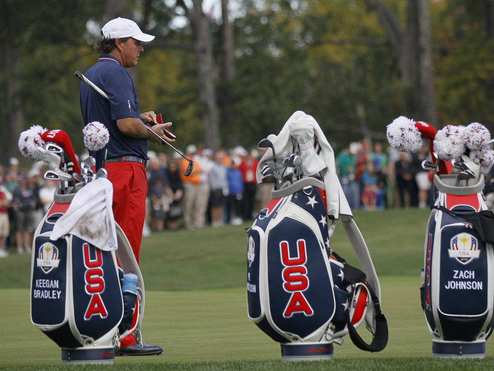 Photo -   USA's Phil Mickelson looks over the third green during a practice round at the Ryder Cup PGA golf tournament Wednesday, Sept. 26, 2012, at the Medinah Country Club in Medinah, Ill. (AP Photo/Charles Rex Arbogast)