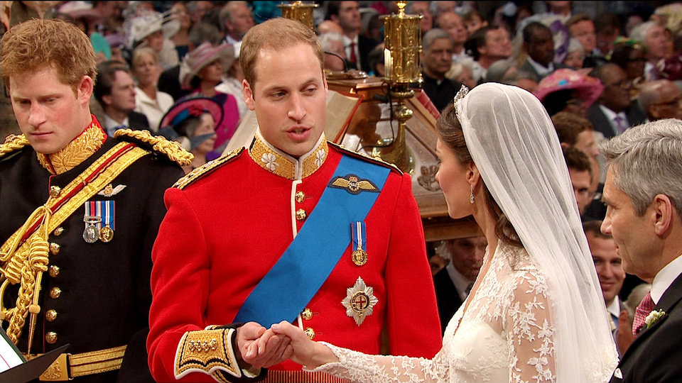 Photo - In this image taken from video, Britain's Prince William, center, takes the hand of his bride, Kate Middleton, as they stand at the altar at Westminster Abbey for the Royal Wedding in London on Friday, April, 29, 2011. (AP Photo/APTN) EDITORIAL USE ONLY NO ARCHIVE PHOTO TO BE USED SOLELY TO ILLUSTRATE NEWS REPORTING OR COMMENTARY ON THE FACTS OR EVENTS DEPICTED IN THIS IMAGE ORG XMIT: RWVM165