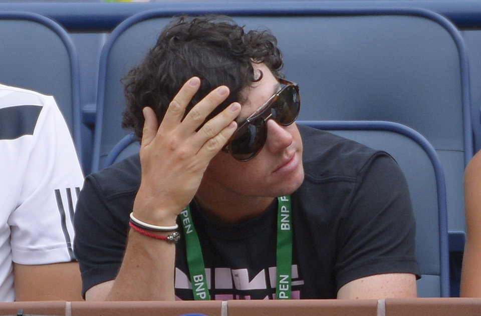 Photo - PGA golfer Rory McIlroy, of Northern Ireland, watches as his fiance, Caroline Wozniacki, of Denmark, plays a fourth round match against Jelena Jankovic, of Serbia, at the BNP Paribas Open tennis tournament, Tuesday, March 11, 2014, in Indian Wells, Calif. (AP Photo/Mark J. Terrill)