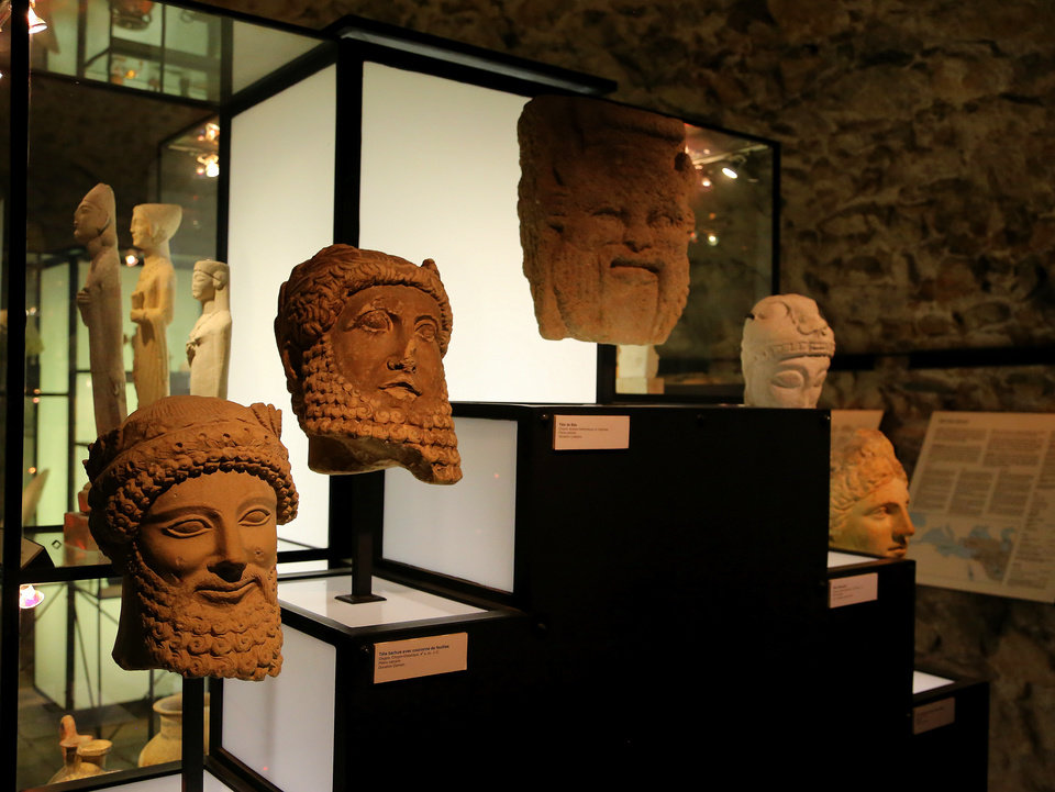 Photo - This picture taken May 11, 2014 shows sculpted heads on display in the Castre Museum in Cannes. Cannes is a favorite destination for the wealthy _ and for celebrities who walk the red carpet at the Cannes Film Festival each May _ but the Riviera resort also offers plenty of simple, inexpensive pleasures, from the beach to street strolls. (AP Photo/Michelle Locke)