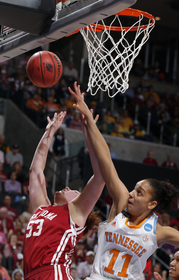 Tennessee's Cierra Burdick (11) blocks the shot of Oklahoma's Joanna McFarland (53) during the college basketball game between the University of Oklahoma and the University of Tennessee at the  Oklahoma City Regional for the NCAA women's college basketball tournament at Chesapeake Energy Arena in Oklahoma City, Sunday, March 31, 2013. Photo by Sarah Phipps, The Oklahoman