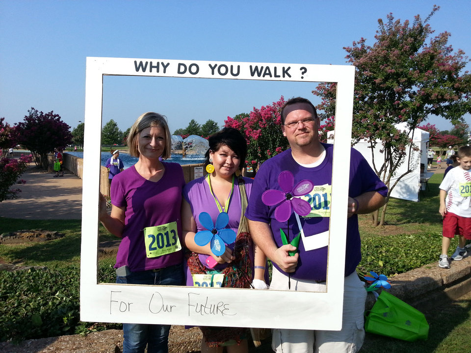 Photo - Brent Whitney stands with his wife Michelle and step-daughter Jessica at the Alzheimer's memory walk. Brent Whitney is a carrier of a genetic mutation that is known to cause Alzheimer's.