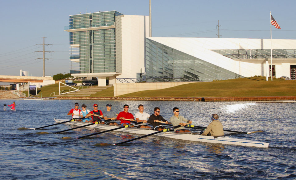 Robin Prendes, second from right sitting in the stroke seat, practicing for the Oklahoma Regatta on the Oklahoma River in Oklahoma City Tuesday, Oct. 1, 2013. In the background is the Devon Boathouse. Photo by Paul B. Southerland, The Oklahoman