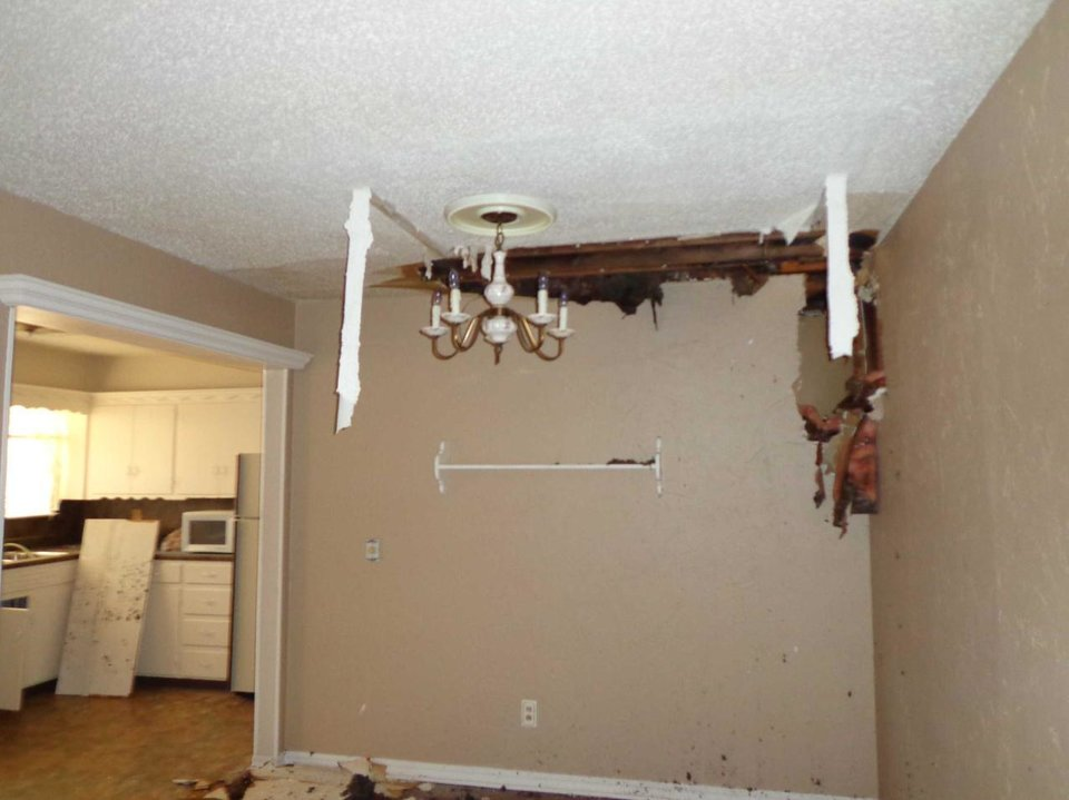 Photo -  Photos show the damage following a 2012 house fire at 4111 Holiday Place in Oklahoma City. In extinguishing the fire and finding its source, firefighters flooded rooms and axed through walls.    -  PHOTOS PROVIDED