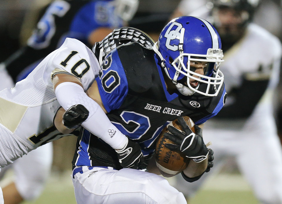 Photo - Deer Creek's Brennan Miyake is brought down by McAlester's Nick Eldridge during a high school football playoff game at Deer Creek, Friday, Nov. 16, 2012. Photo by Bryan Terry, The Oklahoman