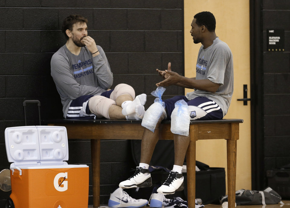 Photo - Memphis Grizzlies center Marc Gasol, left, talks with guard Tony Allen after a practice at NBA basketball training camp Tuesday, Oct. 1, 2013, in Nashville, Tenn. The Grizzlies are scheduled to hold training camp in Nashville through Saturday. (AP Photo/Mark Humphrey)