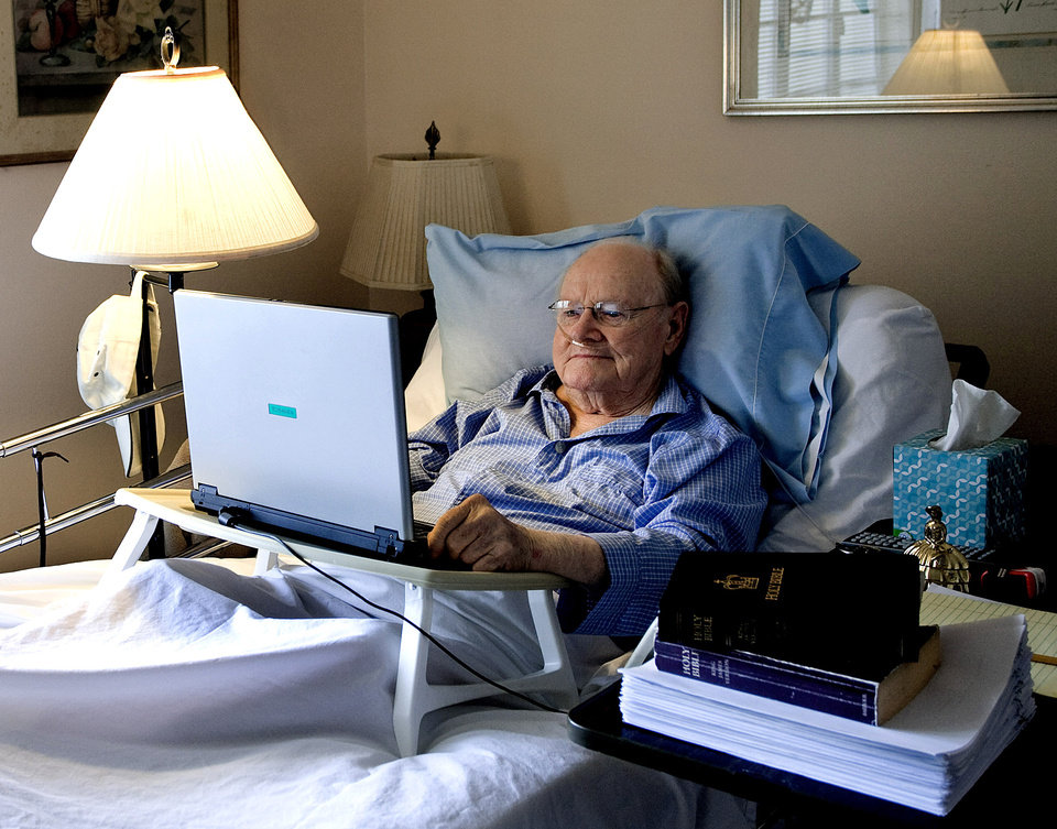 In this Aug. 25, 2012 photo, Gene Patterson, former chairman and chief executive of the Times Publishing Company and its affiliates, checks his email from his bed in St. Petersburg, Fla. Patterson edited 600,000 words out of the King James Bible shown at right, sitting on top of his finished manuscript. Newspaper editor and columnist Eugene Patterson, who helped fellow Southern whites understand the civil rights movement, has died, Saturday, Jan. 12, 2013. He was 89.  (AP Photo/The Tampa Bay Times, Cherie Diez)  TAMPA OUT; CITRUS COUNTY OUT; PORT CHARLOTTE OUT; BROOKSVILLE HERNANDO TODAY OUT