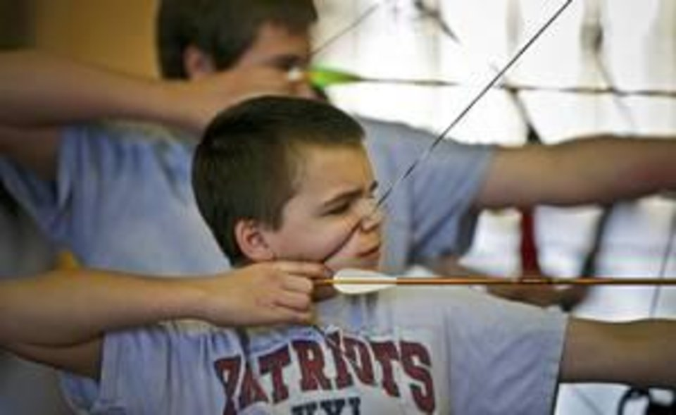 Photo -  Independent Charter Middle School's Alex Hunt competes during the Archery in the Schools Regional Shoot at State Fair Park last month. Photo by Chris Landsberger, The Oklahoman