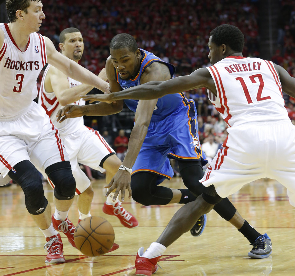 Oklahoma City\'s Kevin Durant (35) tries to get by Houston\'s Omer Asik (3) and Patrick Beverley (12) during Game 4 in the first round of the NBA playoffs between the Oklahoma City Thunder and the Houston Rockets at the Toyota Center in Houston, Texas, Monday, April 29, 2013. Photo by Bryan Terry, The Oklahoman ORG XMIT: OKC1304292101346612