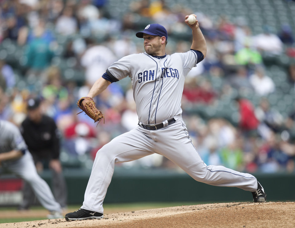 Photo - San Diego Padres starting pitcher Eric Stults delivers a pitch during the first inning a baseball game against the Seattle Mariners in Seattle, Tuesday, June 17, 2014. (AP Photo/Stephen Brashear)