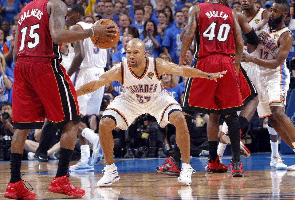 Oklahoma City 's Derek Fisher (37) guards Miami's Mario Chalmers (15) during Game 1 of the NBA Finals between the Oklahoma City Thunder and the Miami Heat at Chesapeake Energy Arena in Oklahoma City, Tuesday, June 12, 2012. Photo by Chris Landsberger, The Oklahoman