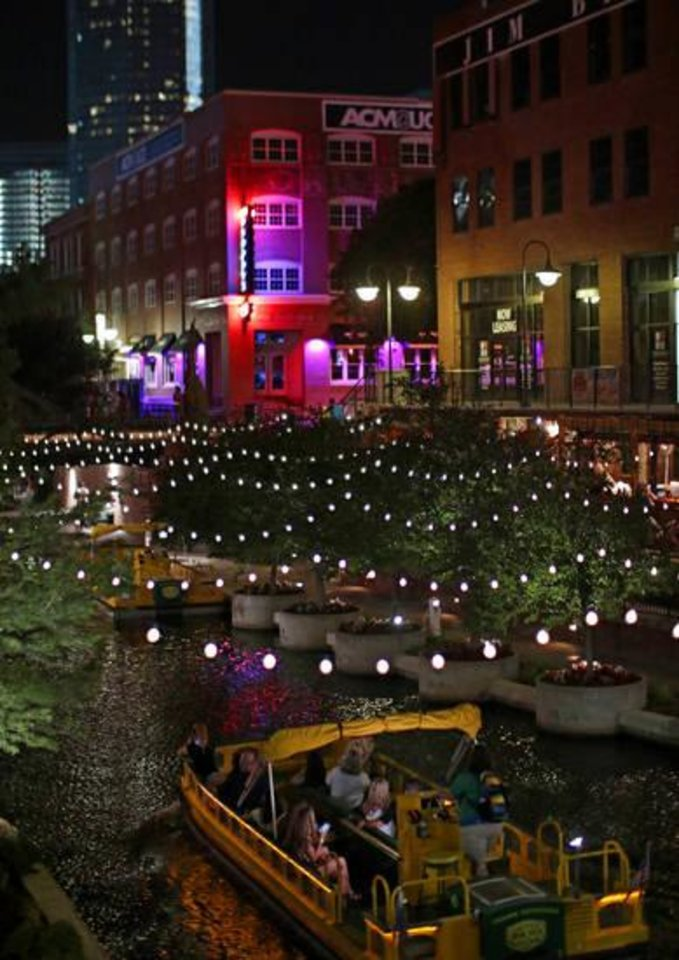 Photo -  Visitors take a cruise down the Bricktown Canal on a recent summer night. [PHOTO BY DOUG HOKE, THE OKLAHOMAN]